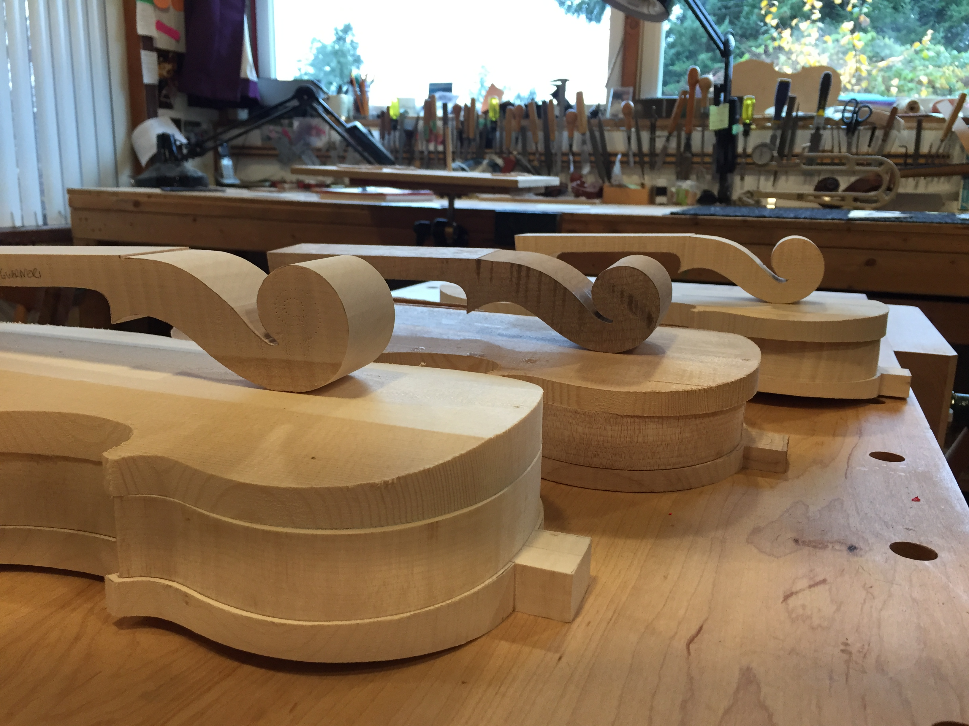 3 violins ready to carve.