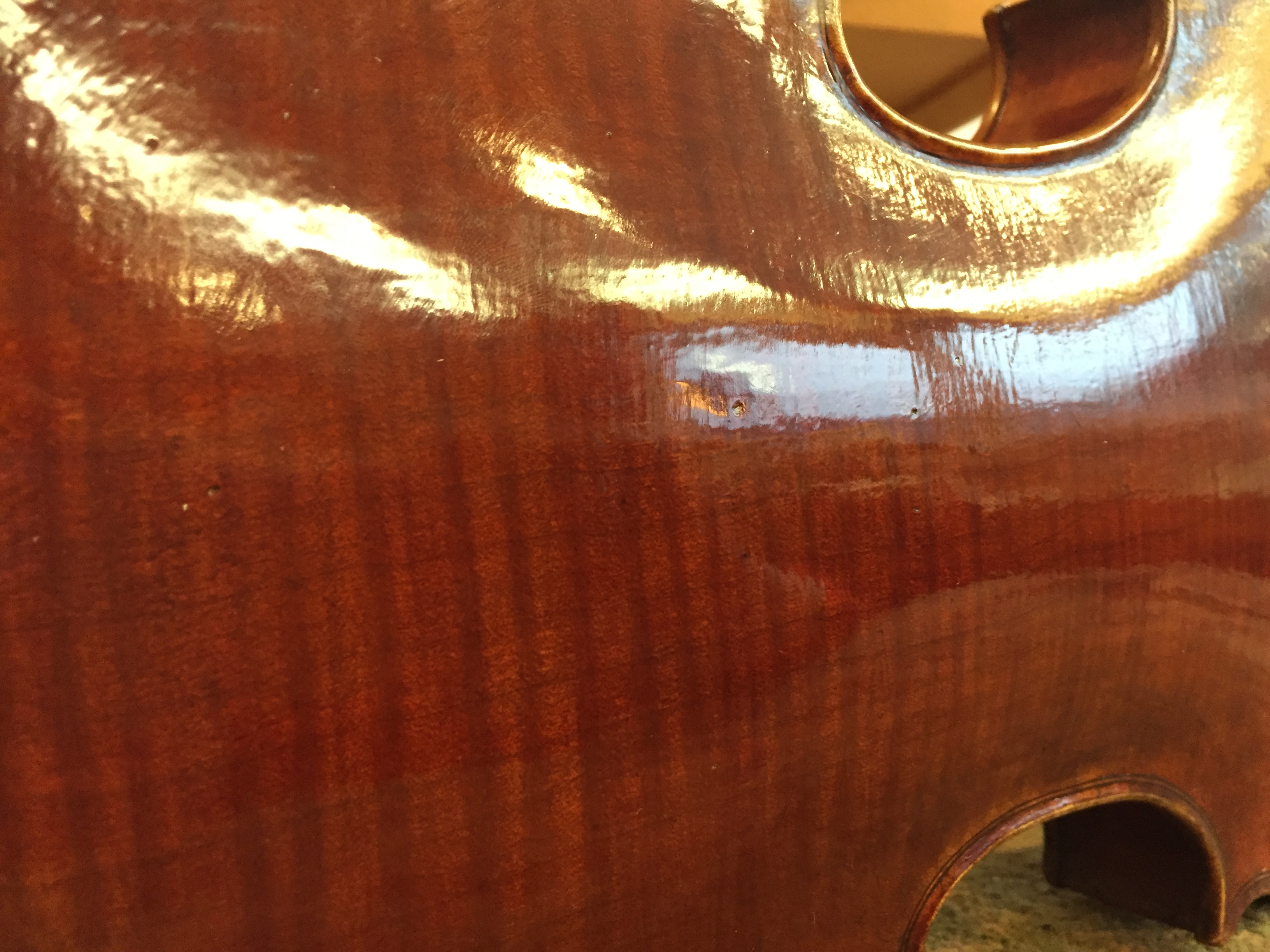 Laura Wallace violin, Big Leaf maple back, red varnish texture.